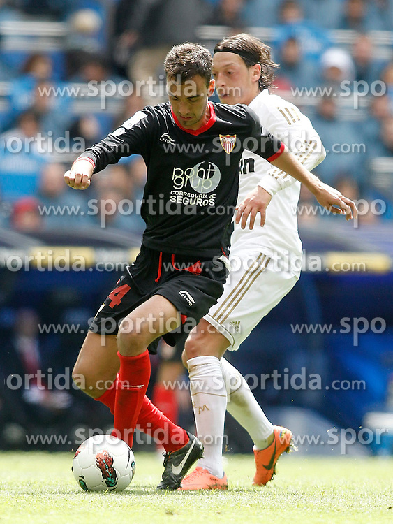 29.04.2012, Santiago Bernabeu Stadion, Madrid, ESP, Primera Division, Real Madrid vs FC Sevilla, 36. Spieltag, im Bild Real Madrid's Mesut Özil against Sevilla's Deivid the football match of spanish 'primera divison' league, 36th round, between Real Madrid and FC Sevilla at Santiago Bernabeu stadium, Madrid, Spain on 2012/04/29. EXPA Pictures © 2012, PhotoCredit: EXPA/ Alterphotos/ Alvaro Hernandez..***** ATTENTION - OUT OF ESP and SUI *****