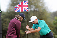 Golf - 2018 Sky Sports British Masters - Thursday, First Round<br /> <br /> Flying the Flag - Francesco Molinari of Italy adjusts the flag for Tommy Fleetwood of England, at Walton Heath Golf Club.<br /> <br /> COLORSPORT/ANDREW COWIE