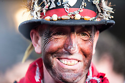 "© Licensed to London News Pictures. 06/01/2016. Haxey UK. Picture shows Dale Smith ""the fool"" at The Haxey Hood that takes place today, The historic event dating back to the 14th century sees teams representing four pubs in Haxey & Westwoodside compete for a leather cylinder known as the hood. After a pub crawl around the participating pubs, the game begins with a famous speech from the ceremonial fool. The game is won when the scrum reaches one of the pubs and the hood is touched by the landlord or landlady. Photo credit: Andrew McCaren/LNP"