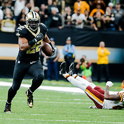 Nov 19, 2017; New Orleans, LA, USA; New Orleans Saints running back Mark Ingram (22) runs past Washington Redskins cornerback Bashaud Breeland (26) during overtime of a game at the Mercedes-Benz Superdome. The Saints defeated the Redskins 34-31 in overtime. Mandatory Credit: Derick E. Hingle-USA TODAY Sports