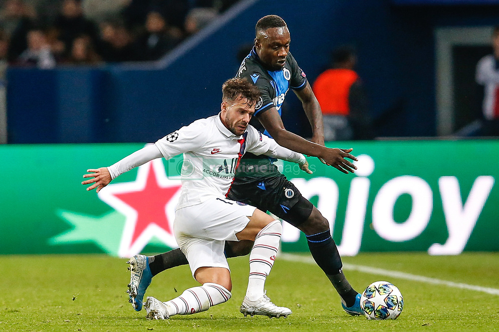 November 6, 2019, Paris, France: PSG's Juan Bernat and Club's Mbaye Diagne fight for the ball during the match between French club Paris Saint-Germain Football Club and Belgian soccer team Club Brugge KV, Wednesday 06 November 2019 in Paris, France, on day four in Group A, in the first round of the UEFA Champions League. (Credit Image: © Bruno Fahy/Belga via ZUMA Press)