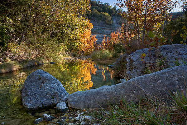 Stock photo of the fall foliage changing colors along a small stream in the Texas Hill Country