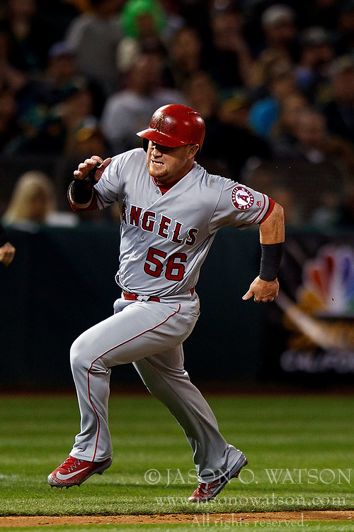 OAKLAND, CA - APRIL 04:  Kole Calhoun #56 of the Los Angeles Angels of Anaheim rounds third base to score a run against the Oakland Athletics during the fifth inning at the Oakland Coliseum on April 4, 2017 in Oakland, California. The Los Angeles Angels of Anaheim defeated the Oakland Athletics 7-6. (Photo by Jason O. Watson/Getty Images) *** Local Caption *** Kole Calhoun
