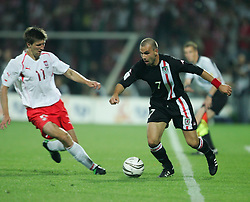 WARSAW, POLAND - WEDNESDAY, SEPTEMBER 7th, 2005: Wales' Carl Fletcher and Poland's Grzegorz Rasiak during the World Cup Group Six Qualifying match at the Legia Stadium. (Pic by David Rawcliffe/Propaganda)
