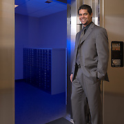 Assistant Branch Manager is photographed at the doorway to the vault of the Comerica Bank branch in East Village, San Diego. Commercial photography by Dallas corporate photographer William Morton of Morton Visuals.