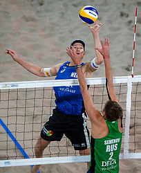 06-01-2019 NED: Dela Beach Open, Den Haag<br /> Netherlands lost the bronze medal from Russia 1-2 /  Robert Meeuwsen #2 and block Konstantin Semenov #2 RUS