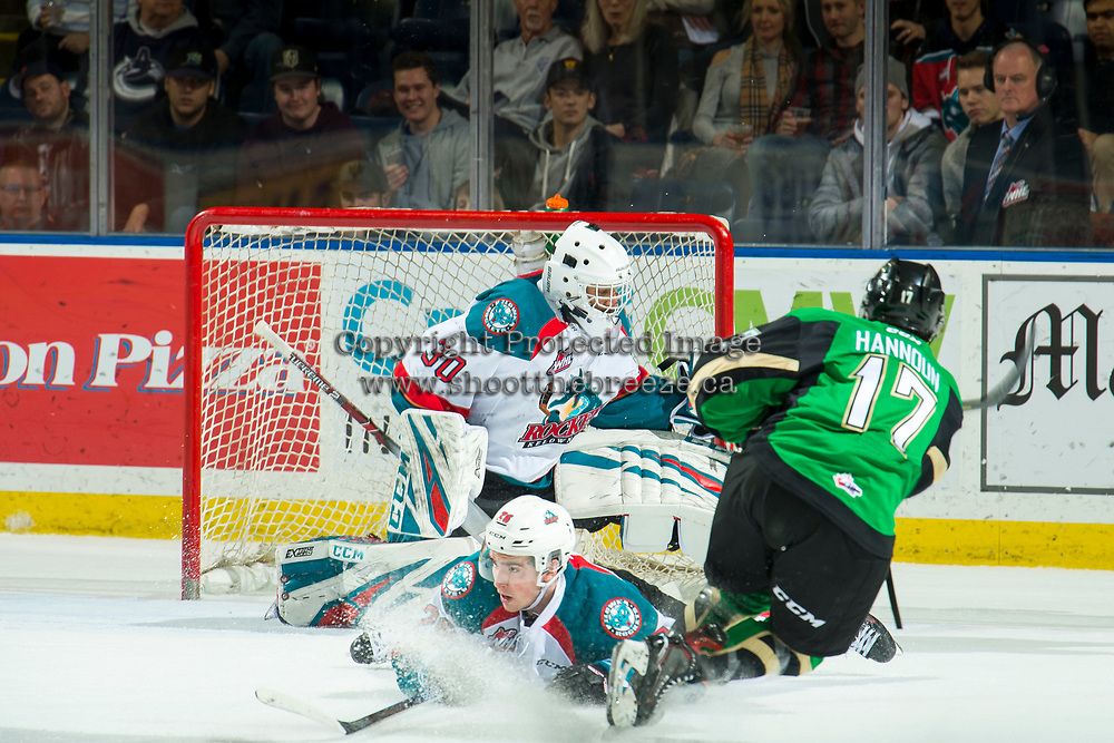 KELOWNA, CANADA - JANUARY 19:  Liam Kindree #26 falls to the ice to block a shot as Roman Basran #30 of the Kelowna Rockets makes a save on a shot by Dante Hannoun #17 of the Prince Albert Raiders on January 19, 2019 at Prospera Place in Kelowna, British Columbia, Canada.  (Photo by Marissa Baecker/Shoot the Breeze)