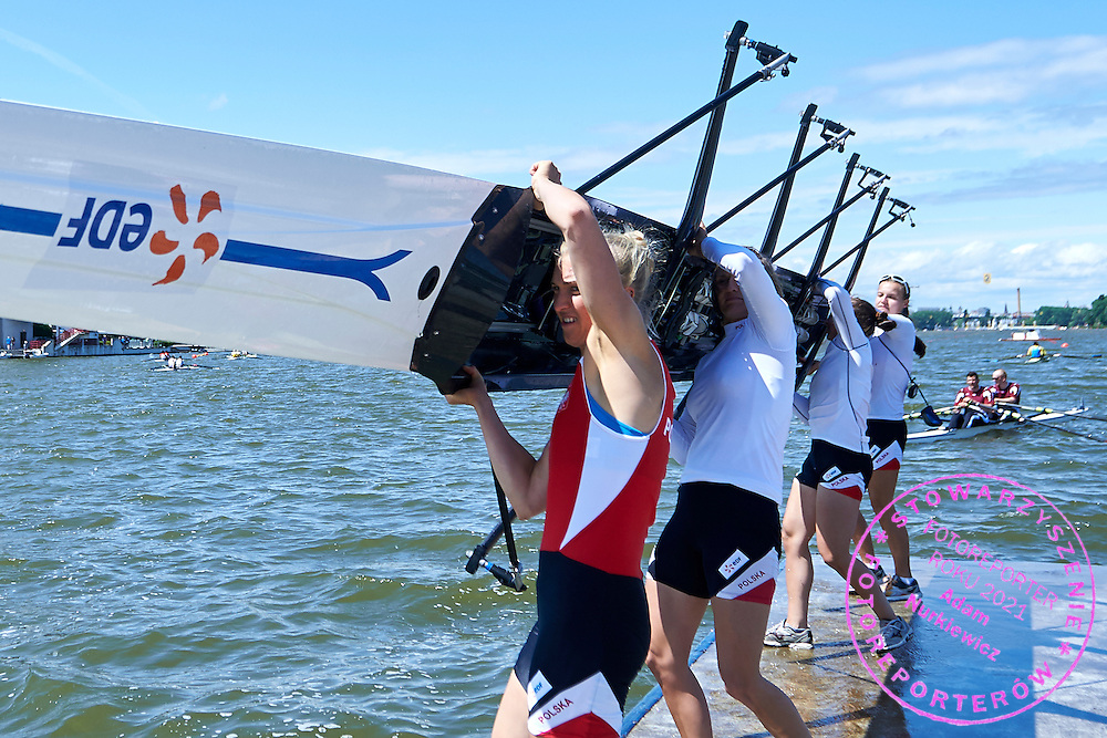 (bow) Agnieszka Kobus and Joanna Leszczynska and Maria Springwald and (stroke) Monika Ciaciuch all from Poland lift their boat after Semifinal at Women&rsquo;s Quadruple Sculls (W4x) during second day the 2015 European Rowing Championships on Malta Lake on May 30, 2015 in Poznan, Poland<br /> Poland, Poznan, May 30, 2015<br /> <br /> Picture also available in RAW (NEF) or TIFF format on special request.<br /> <br /> For editorial use only. Any commercial or promotional use requires permission.<br /> <br /> Mandatory credit:<br /> Photo by &copy; Adam Nurkiewicz / Mediasport