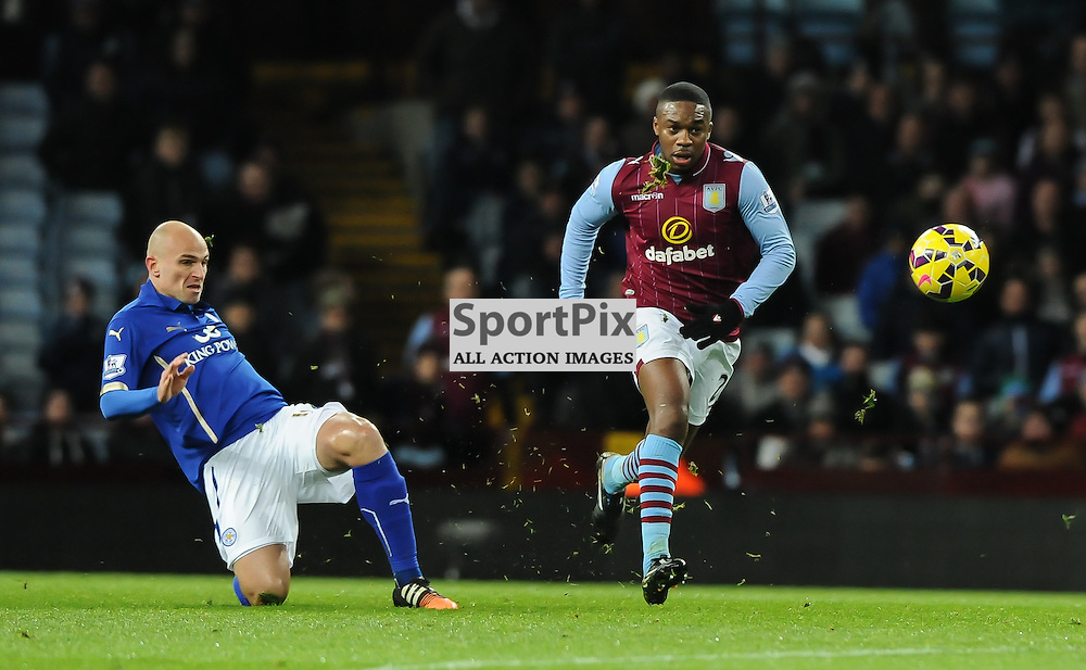 Esteban Cambiasso gets the ball away from Leandro Bacuna (c) Simon Kimber | SportPix.org.uk
