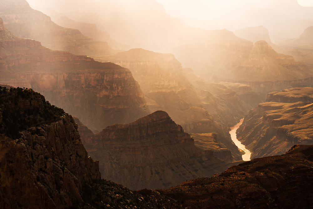 The warmth of the summer sun illuminates the depths of the Grand Canyon reaching all the way down to the Colorado River.
