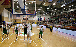 Smiljan Pavic of Krka vs Dino Muric of Olimpija during basketball match between KK Union Olimpija Ljubljana and KK Krka Novo mesto of finals of 11th Slovenian Spar Cup 2012, on February 19, 2012 in Sports hall Brezice,  Brezice, Slovenia. (Photo By Vid Ponikvar / Sportida.com)