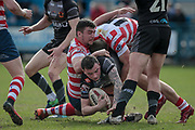 Jordan Lilley (Bradford Bulls) is brought to the ground during the Kingstone Press Championship match between Oldham Roughyeds and Bradford Bulls at Bower Fold, Oldham, United Kingdom on 2 April 2017. Photo by Mark P Doherty.