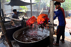 April 26, 2018 - Dhaka, Bangladesh - Bangladeshi labors working in the Batik Cloth industry at Narsingdi area near Dhaka, Bangladesh, on April 26, 2018. Each Worker earns par day 400-500 Taka or 5-6 US Dollar. (Credit Image: © Str/NurPhoto via ZUMA Press)