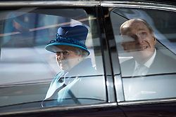 © Licensed to London News Pictures . 14/11/2013 . Manchester , UK . The Queen and Prince Philip the Duke of Edinburgh leave in the royal car . Queen Elizabeth II and the Duke of Edinburgh visit the Coop building at 1 Angel Square , Manchester , this morning ( 14th November 2013 ) . Photo credit : Joel Goodman/LNP
