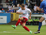 Alex Harvey clears the ball during the Pre-Season Friendly match between Barrow and Carlisle United at Holker Street, Barrow, United Kingdom on 23 July 2016. Photo by Pete Burns.