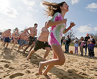 Not quite balmy but a pleasant November day for plungers as they take to the water on Saturday afternoon for the 5th annual Salvation Army Turkey Plunge held at Weirs Beach.  (Karen Bobotas/for the Laconia Daily Sun)