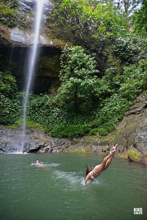 Visitors swim at La Sierpe Watefall, National Natural Park of Uramba,  Bahia Malaga, Colombian Pacific Coast