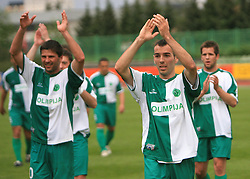 Amir Karic, Adnan Alagic of Olimpija celebrate after football match of 2nd SNL between NK Olimpija Ljubljana and NK Zagorje, on May 03, 2009, in ZAK stadium, Ljubljana, Slovenia. Olimpija won 9:0 and 4 Rounds before the end won the 1st place in 2nd SNL. Next year they will play in First Slovenian League. (Photo by Vid Ponikvar / Sportida)