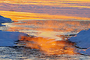 Mist rising off the waters of Setting Lake at Sasagiu Raapids on an extremely cold winter day (-40 degrees Celsius)<br /> Sasagiu Rapids<br /> Manitoba<br /> Canada