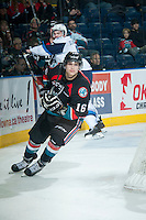 KELOWNA, CANADA - DECEMBER 3: Kris Schmidli #16 of Kelowna Rockets skates behind the net against the Saskatoon Blades on December 3, 2014 at Prospera Place in Kelowna, British Columbia, Canada.  (Photo by Marissa Baecker/Shoot the Breeze)  *** Local Caption *** Kris Schmidli;