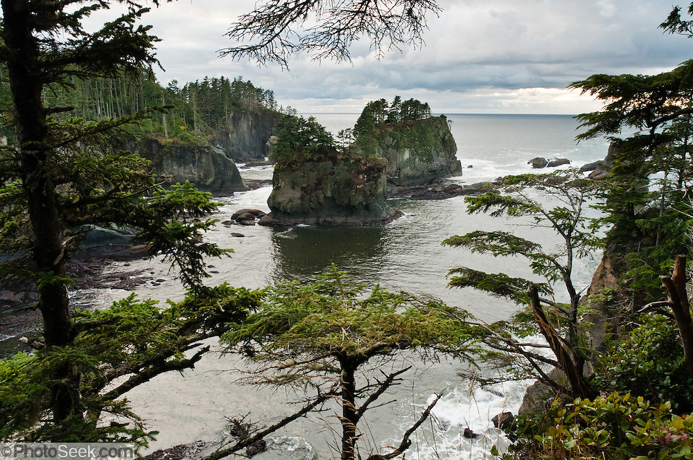 Cape Flattery, the northwesternmost point of the contiguous United States, can be reached from a short walk on boardwalks and trail in Clallam County on the Makah Reservation, Washington. Admire coastal scenery, sea stacks, and surf. Here the Strait of Juan de Fuca joins the Pacific Ocean. Offshore of the Olympic Peninsula, the Olympic Coast National Marine Sanctuary extends from Cape Flattery in the north to Copalis River in the south.