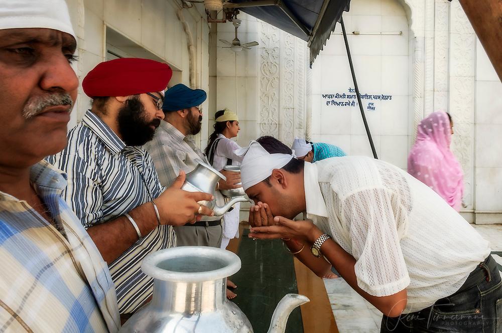 Drinking water at the Gurudwara Bangla Sahib
