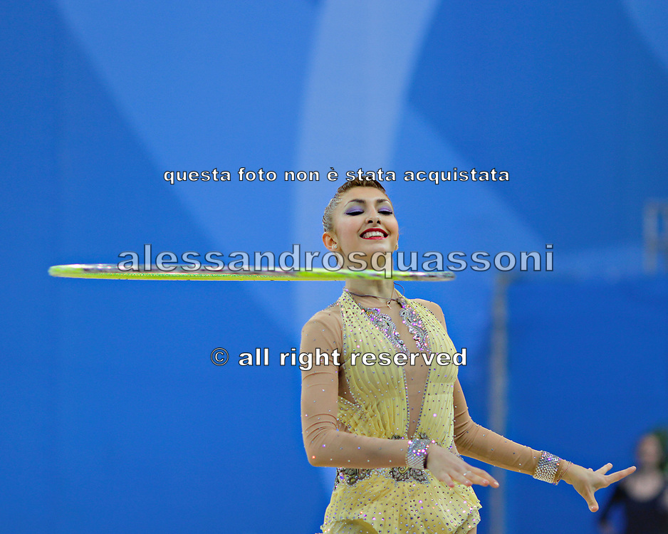 Filiou Varvara during qualifying at hoop in Pesaro World Cup 26 April 2013. Varvara, born on 29 December 1994 in Maurosi,Greece. She is the most famous and awarded Greek athlete of this sport. Varvara is an 8 time Greek National All-around Champion.