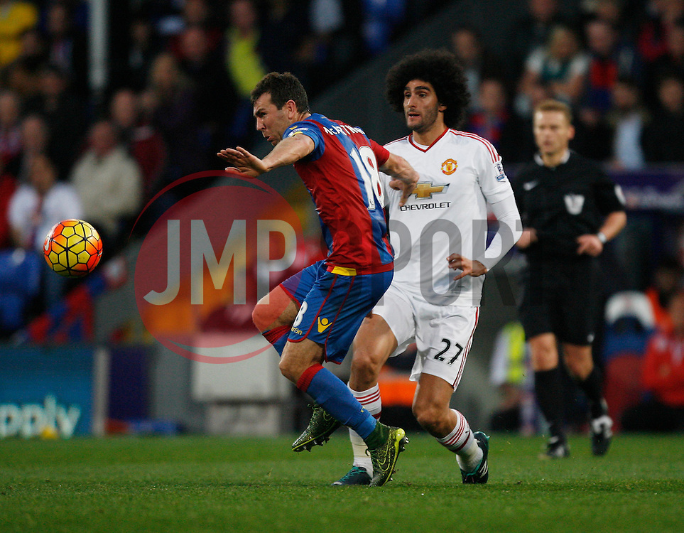 James McArthur of Crystal Palace (L) and Marouane Fellaini of Manchester United in action  - Mandatory byline: Jack Phillips/JMP - 07966386802 - 31/10/2015 - SPORT - FOOTBALL - London - Selhurst Park Stadium - Crystal Palace v Manchester United - Barclays Premier League
