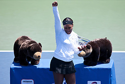 July 31, 2011; Stanford, CA, USA;  Serena Williams (USA) celebrates with the championship trophy after her match against Marion Bartoli (FRA), not pictured, during the finals of the Bank of the West Classic women's tennis tournament at the Taube Family Tennis Stadium. Williams defeated Bartoli 7-5, 6-1.