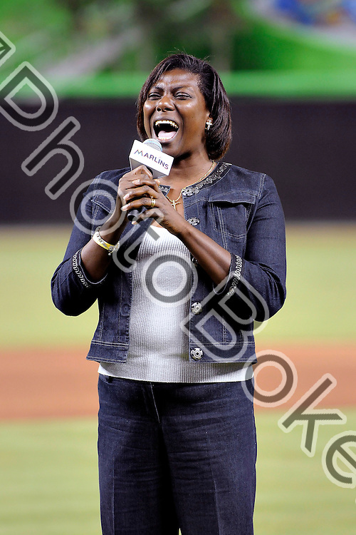 2012 March 07 - The National Anthem being sung by FIU's Felecia Townsend. Florida International University Golden Panthers fell to the Miami Marlins, 5-1, during an exhibition game at Miami Marlins Park, Miami, Florida. (Photo by: www.photobokeh.com / Alex J. Hernandez) 1/320 f/2.8 ISO800 300mm This image is copyright PhotoBokeh.com and may not be reproduced or retransmitted without express written consent of PhotoBokeh.com. ©2012 PhotoBokeh.com - All Rights Reserved