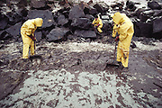 Oil spill cleanup on a beach from an oil tanker accident. The tanker, the Amoco Cadiz, split in two after running aground on rocks three miles off the coast of Britanny, France., near Portsall on March 16, 1978.