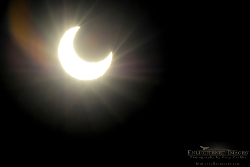 Crescent sun as the moon passes across the sun in a partial solar eclipse, May 20, 2012