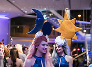 """Models Rachel and Lorna Svendsen display the """"Celestial Twins"""" hair sculpture during """"Hair Affair: The Art of Hair"""" at Madison Museum of Contemporary Art in Madison, WI on Thursday, April 25, 2019. The sixth biennial brought an array of designers and stylists from across Wisconsin to create under the theme of """"Zodiac."""""""