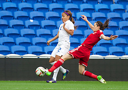 CARDIFF, WALES - Tuesday, August 21, 2014: Wales' Nicola Cousins in action against England's Alex Scott during the FIFA Women's World Cup Canada 2015 Qualifying Group 6 match at the Cardiff City Stadium. (Pic by Ian Cook/Propaganda)