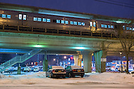 Merrick, New York, USA. March 3, 2015. During peak of evening commute, an LIRR train arrives on elevated platform as snow falls at Merrick Long Island Rail Road LIRR train station. The area is under a Winter Weather Advisory, and a Winter Storm Watch for hazardous conditions is in effect from Wednesday night to Thursday night in Long Island, New York City and other nearby areas of the northeast.