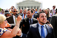 Jeff Zarrillo (R) and Paul Katami (C), one of the couples at the center of the Supreme Court challenge to U.S. laws prohibiting same-sex marriage, triumphantly greet Zarrillo's mother as they leave the Supreme Court building following the court's favorable ruling in their case against California's anti-gay marriage Proposition 8 ballot initiative.
