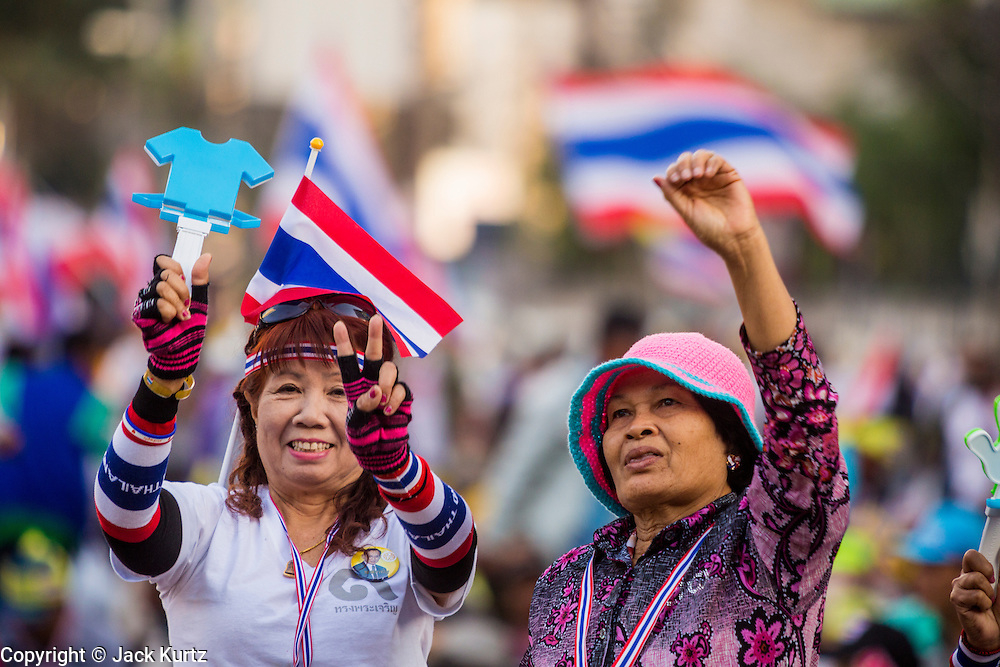"""13 JANUARY 2014 - BANGKOK, THAILAND: A woman dances and cheers during an anti-government rally in the Asoke intersection in Bangkok. Tens of thousands of Thai anti-government protestors took to the streets of Bangkok Monday to shut down the Thai capitol. The protest was called """"Shutdown Bangkok"""" and is expected to last at least a week. The Shutdown Bangkok protest is a continuation of protests that started in early November. There have been shootings almost every night at different protests sites around Bangkok, including two Sunday night, but the protests Monday were peaceful. The malls in Bangkok stayed open Monday but many other businesses closed for the day and mass transit was swamped with both protestors and people who had to use mass transit because the roads were blocked.    PHOTO BY JACK KURTZ"""