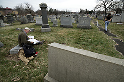 Hundreds of volunteers clean up and map gravestones on Feb. 28, 2017, after recent acts of vandalism damaged hundreds of headstones at the Jewish cemetery, located in Northeast section of the city. Local Police officials say the vandalism happened between Friday night, perhaps even earlier, and Sunday morning.