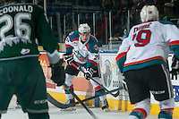 KELOWNA, CANADA - JANUARY 23: Gage Quinney #20 of Kelowna Rockets passes the puck along the boards against the Everett Silvertips on January 23, 2015 at Prospera Place in Kelowna, British Columbia, Canada.  (Photo by Marissa Baecker/Shoot the Breeze)  *** Local Caption *** Gage Quinney;