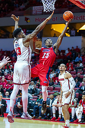 NORMAL, IL - December 18: Godwin Boahen takes an off balanced shot due to the presence of defender Rey Idowu during a college basketball game between the ISU Redbirds and the UIC Flames on December 18 2019 at Redbird Arena in Normal, IL. (Photo by Alan Look)