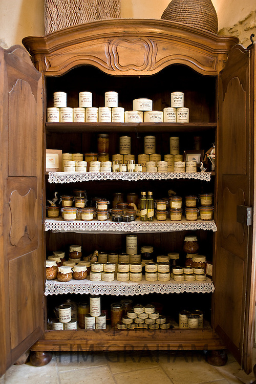 Foie gras and other farm products in kilner preserving jars in armoire on sale at farm, La Ferme de Charnaillas, Dordogne, France