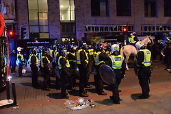 """© Licensed to London News Pictures. 28/07/2017. London, UK. Protester take to the streets of Dalston and clash with police following the death of Rashan Charles whilst being arrested by police.  A statement from Scotland Yard said Mr Charles went into a shop, where he was seen """"trying to swallow an object"""" and it was then police officers struggled with him to make an arrest. Photo credit: Ray Tang/LNP"""
