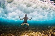 Man doing yoga underwater, Vunanui Bay, Viti Levu, Fiji