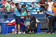 Ashleigh Barty (AUS) gets her ankle taped during her match against Svetlana Kuznetsova (RUS) during the Western and Southern Open tennis tournament at Lindner Family Tennis Center, Saturday, Aug 17, 2019, in Mason, OH. (Jason Whitman/Image of Sport)