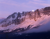 Full Moon setting over Singleshot Mountain, Glacier National Park Montana USA