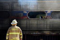 With a triple digits heat index, firefighters battle a fire on a commuter train, at SEPTA's Glenside, PA station in Suburban Philadelphia, on August 29, 2018.