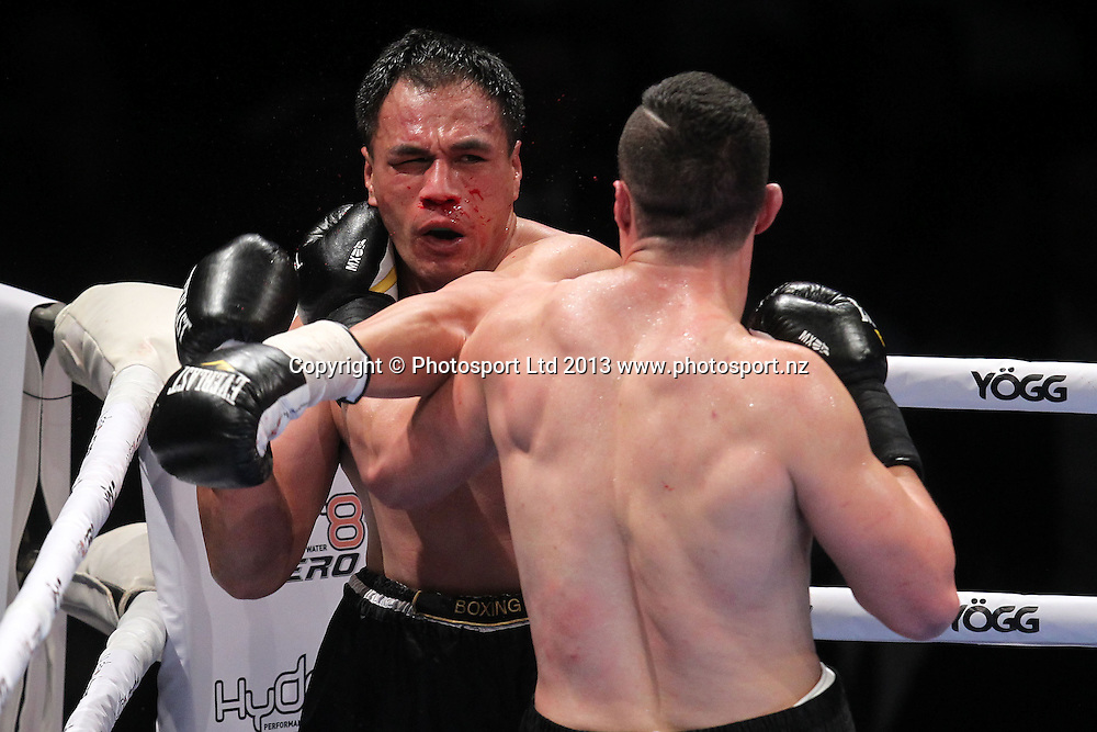 Joseph Parker wins the Hydr8 Zero Fight Night bout between Joseph Parker in black and yellow v Afa Tatupu in black, 10 October 2013. Photo: Fiona Goodall/photosport.co.nz