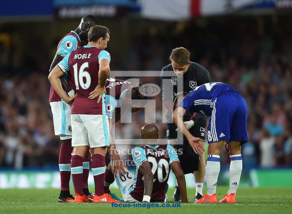 West Ham United's Andre Ayew sits injured on the pitch during the Premier League match at Stamford Bridge, London<br /> Picture by Daniel Hambury/Focus Images Ltd +44 7813 022858<br /> 15/08/2016