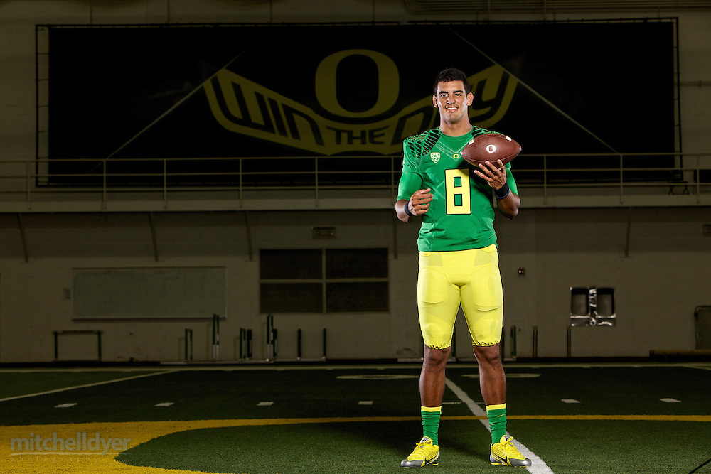 Oregon Ducks Quarterback Marcus Mariotta poses for a photo before the start of the 2014 season in Eugene, OR on August 15, 2014. <br /> <br /> Photo by Craig Mitchelldyer<br /> www.craigmitchelldyer.com