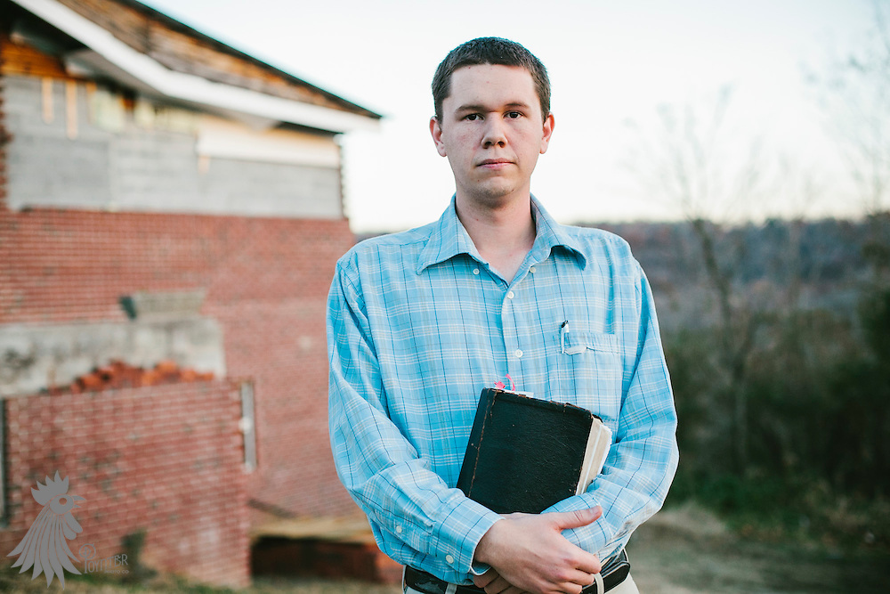 LaFollette, TN - Nov. 14, 2013: Andrew Hamblin, pastor of the Tabernacle Church of God, in front of his church. The church, whose congregation regularly handles snakes as part of services, had their snakes confiscated in early November by the Tennessee Wildlife Resources Agency for violating a Tennessee law against handling serpents in church. <br /> <br /> Photo by Shawn Poynter